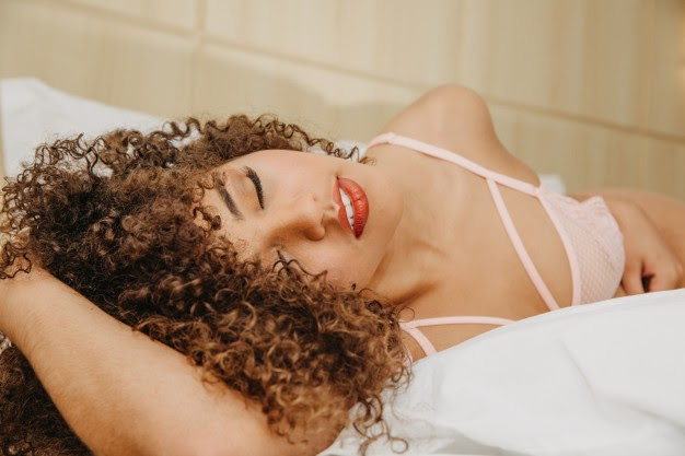 latin Dominican beautiful-young woman with curly hair